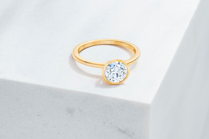 Mercer VOW by Ring Concierge antique-style round bezel engagement ring in yellow gold. 33281414234200