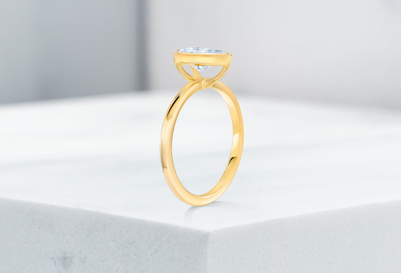 Mercer VOW by Ring Concierge pear bezel engagement ring in yellow gold. 33281414103128