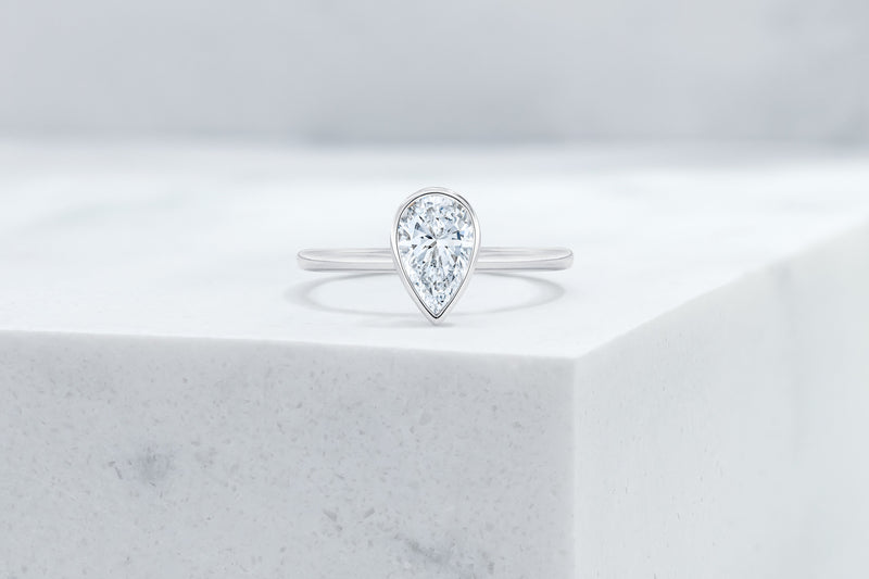 Mercer VOW by Ring Concierge pear bezel engagement ring in platinum. 33281414168664