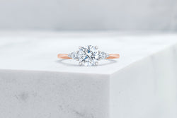 Waverly VOW by Ring Concierge round with pear illusion side stones engagement ring in rose gold. 33281406697560