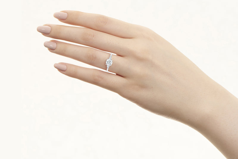 Waverly VOW by Ring Concierge round with pear illusion side stones engagement ring in platinum. 33281406730328