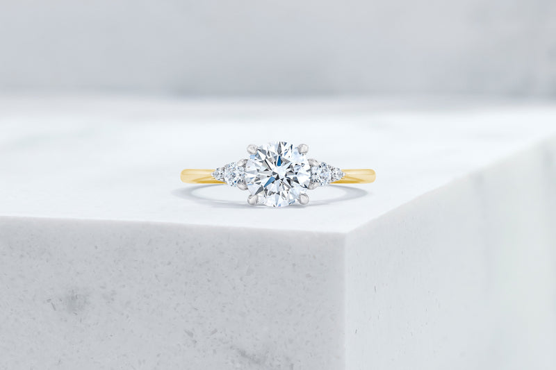 Waverly VOW by Ring Concierge round with pear illusion side stones engagement ring in yellow gold. 33281406664792