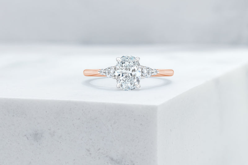 Waverly VOW by Ring Concierge oval with pear illusion side stones engagement ring in rose gold. 33281406795864