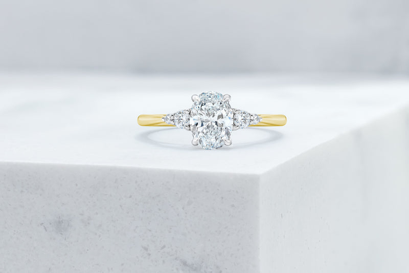 Waverly VOW by Ring Concierge oval with pear illusion side stones engagement ring in yellow gold. 33281406763096