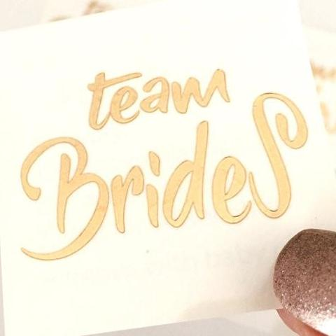 team brides temporary tattoo before application