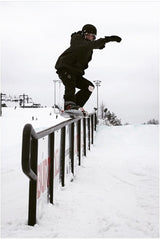 marhar snowboarder press rail