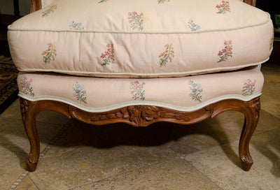 A Pair of Louis XV Walnut Tub Bergeres