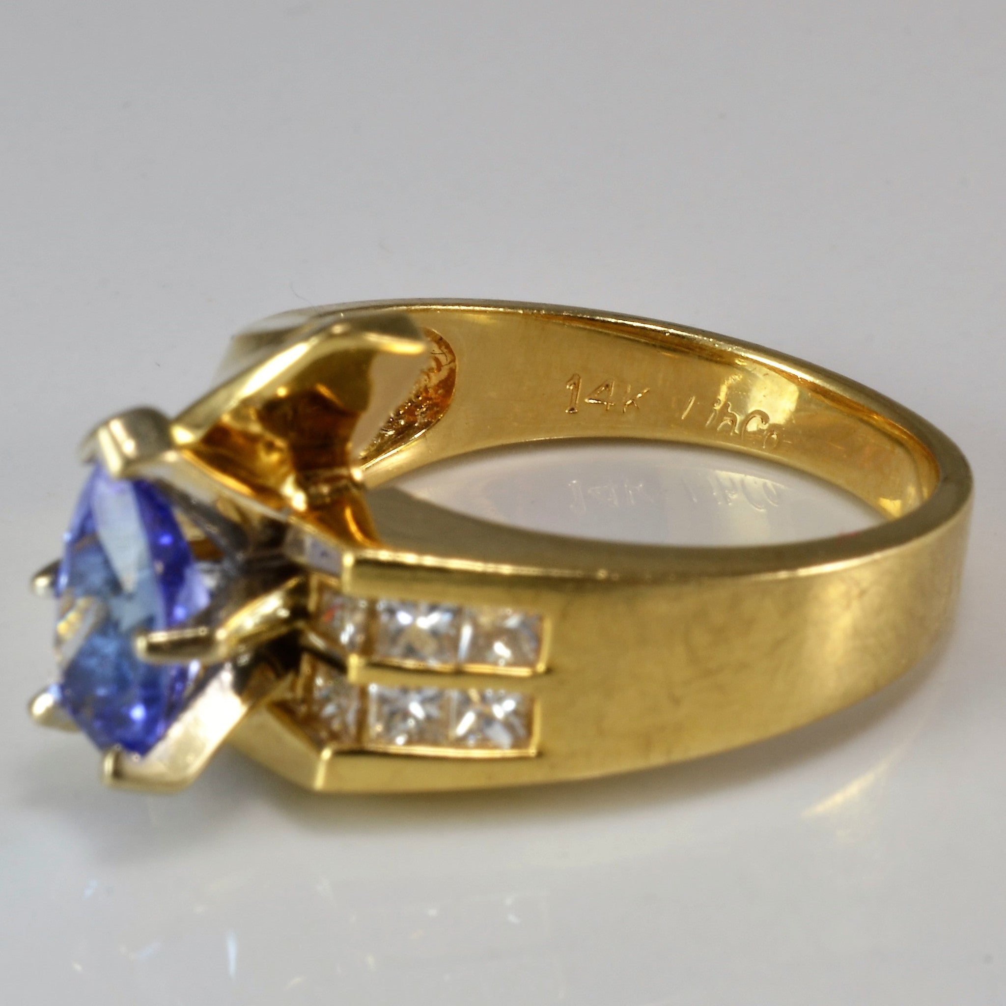with princess diamond white cut ring round tanzanite l gold center