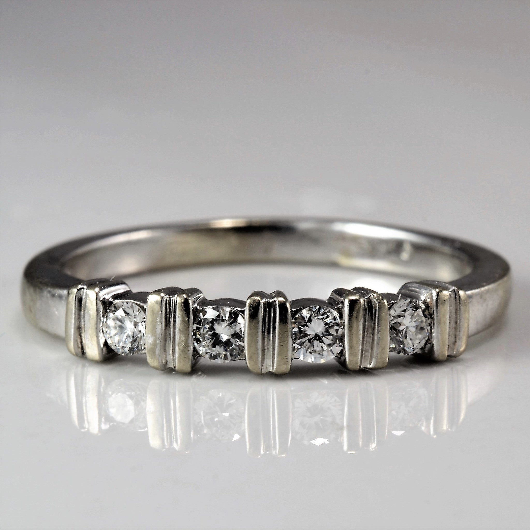 Four Stone Diamond Wedding Band | 0.10 ctw, SZ 4.5 |