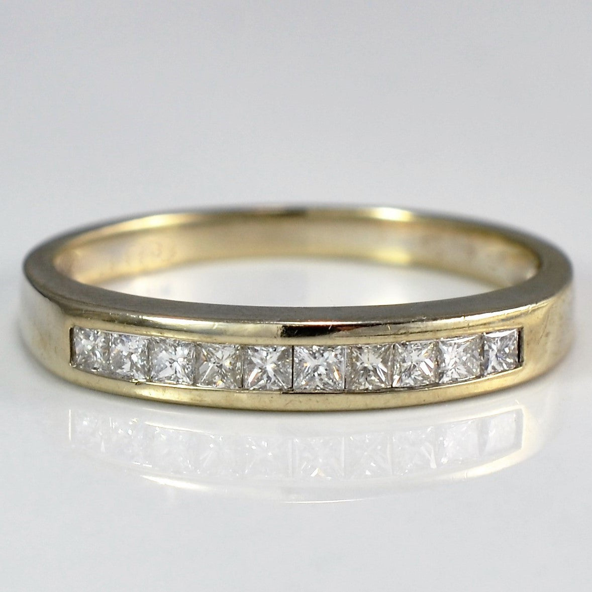 gold channel set wedding a wide round diamond upon band products once white in