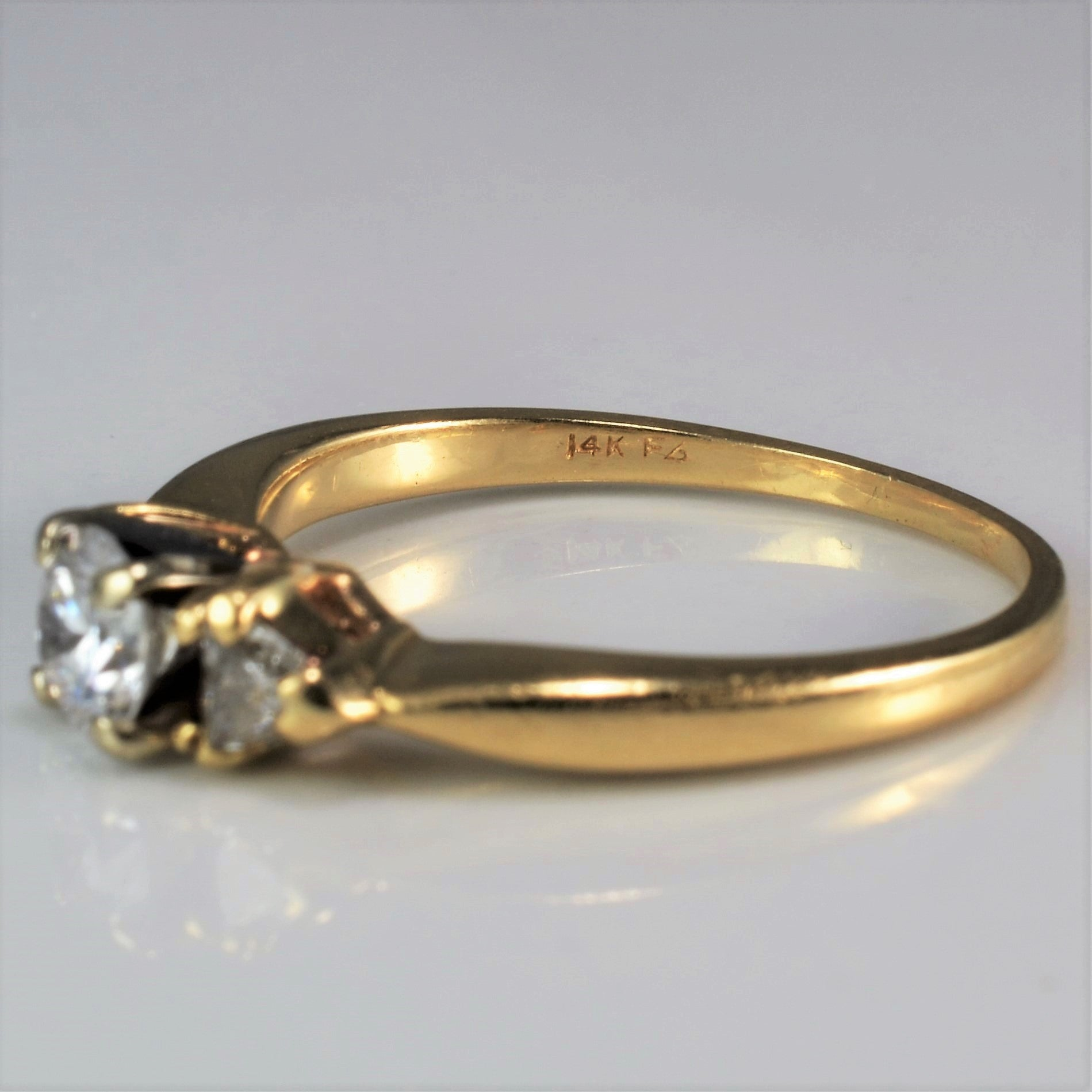 Three Stone Trillion Accent Engagement Ring | 0.62 ctw, SZ 7 |