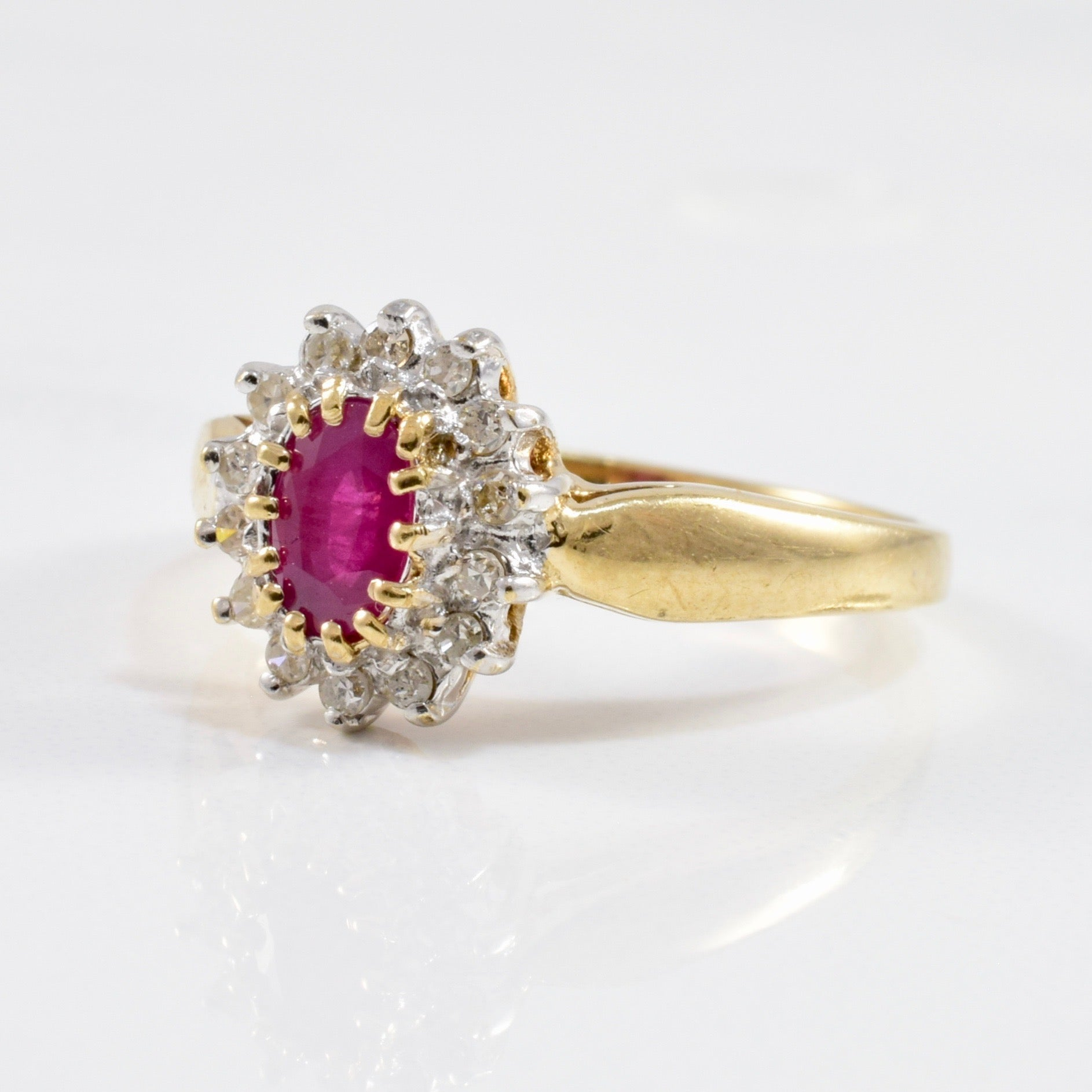 Diamond Halo Ruby Ring | 0.12ctw, 0.55ct | SZ 7 |