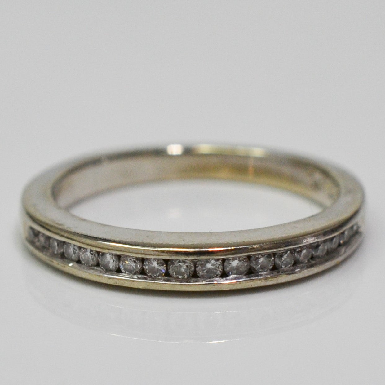 Channel Set Semi Eternity Band | 0.10 ctw, SZ 5 |