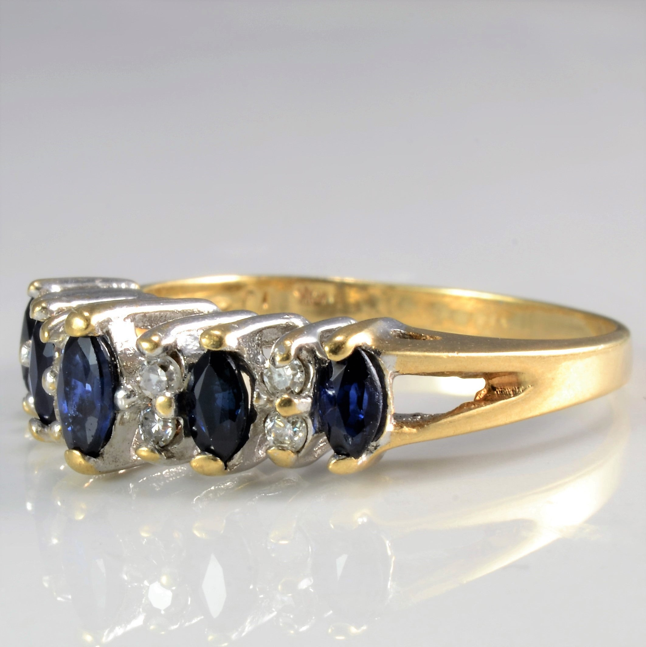 sapphire to oval centre with and an diamond ring pin set marquise the