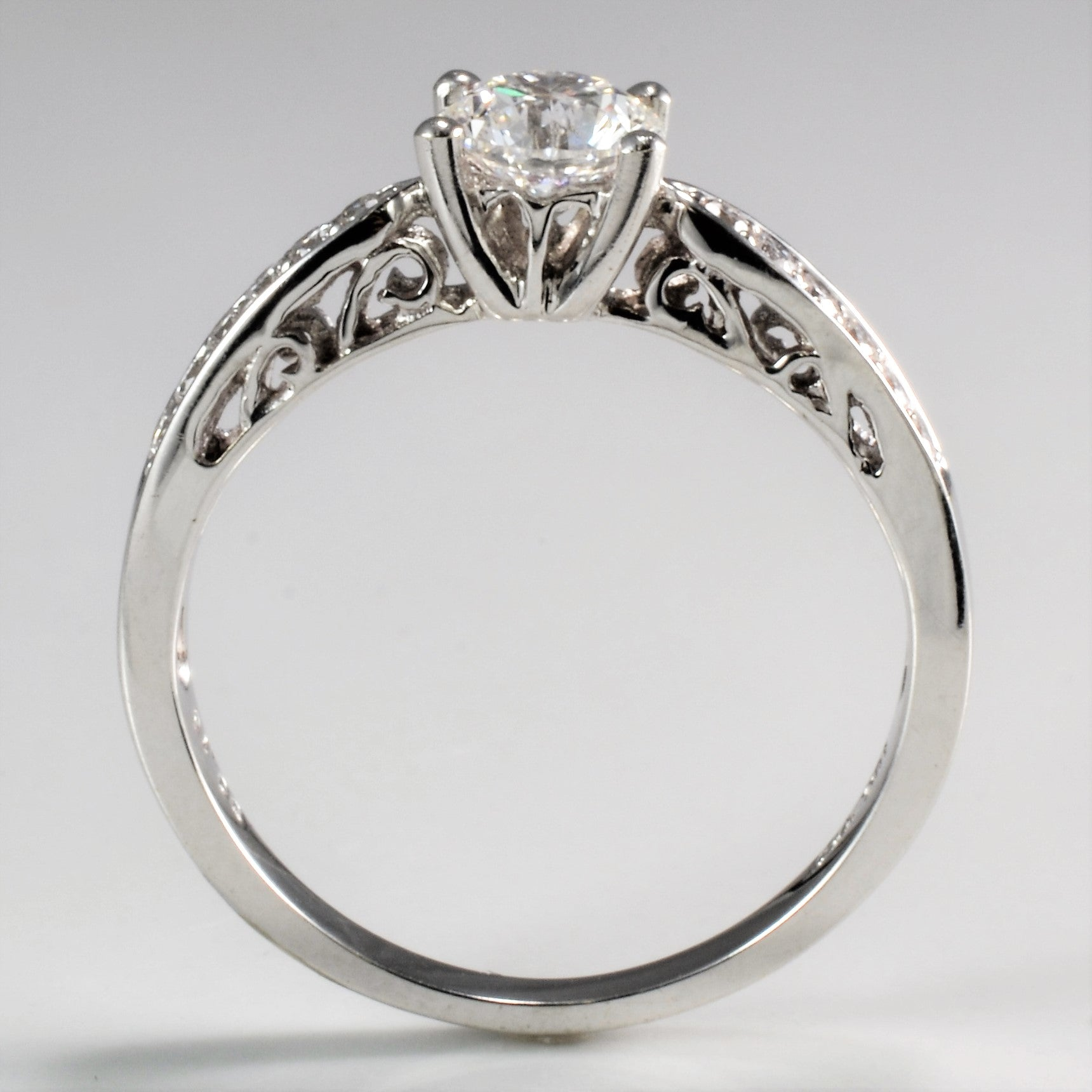 Solitaire & Channel Accents Diamond Engagement Ring | 0.73 ctw, SZ 7 |