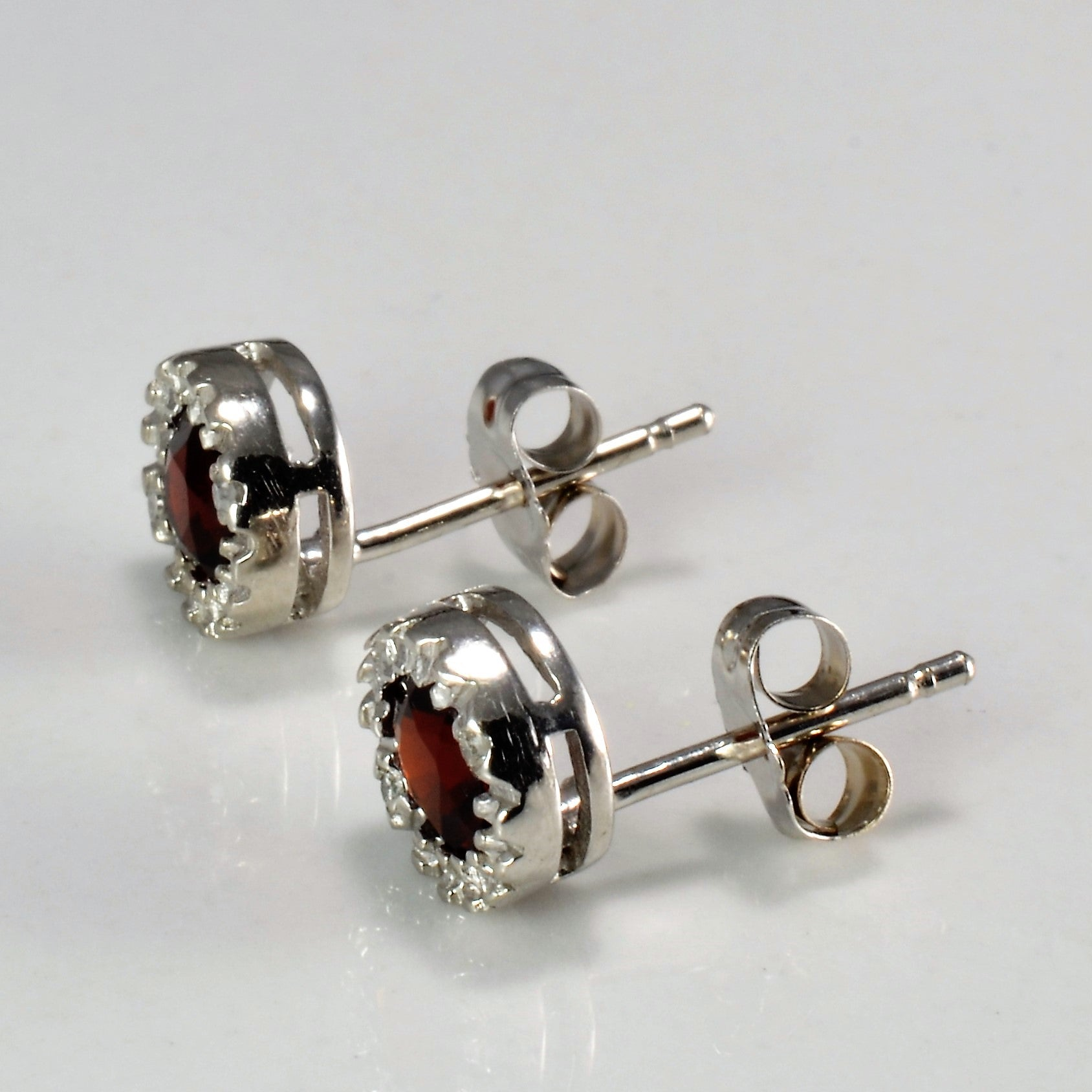 Halo Style Garnet & Diamond Stud Earrings | 0.02 ctw |