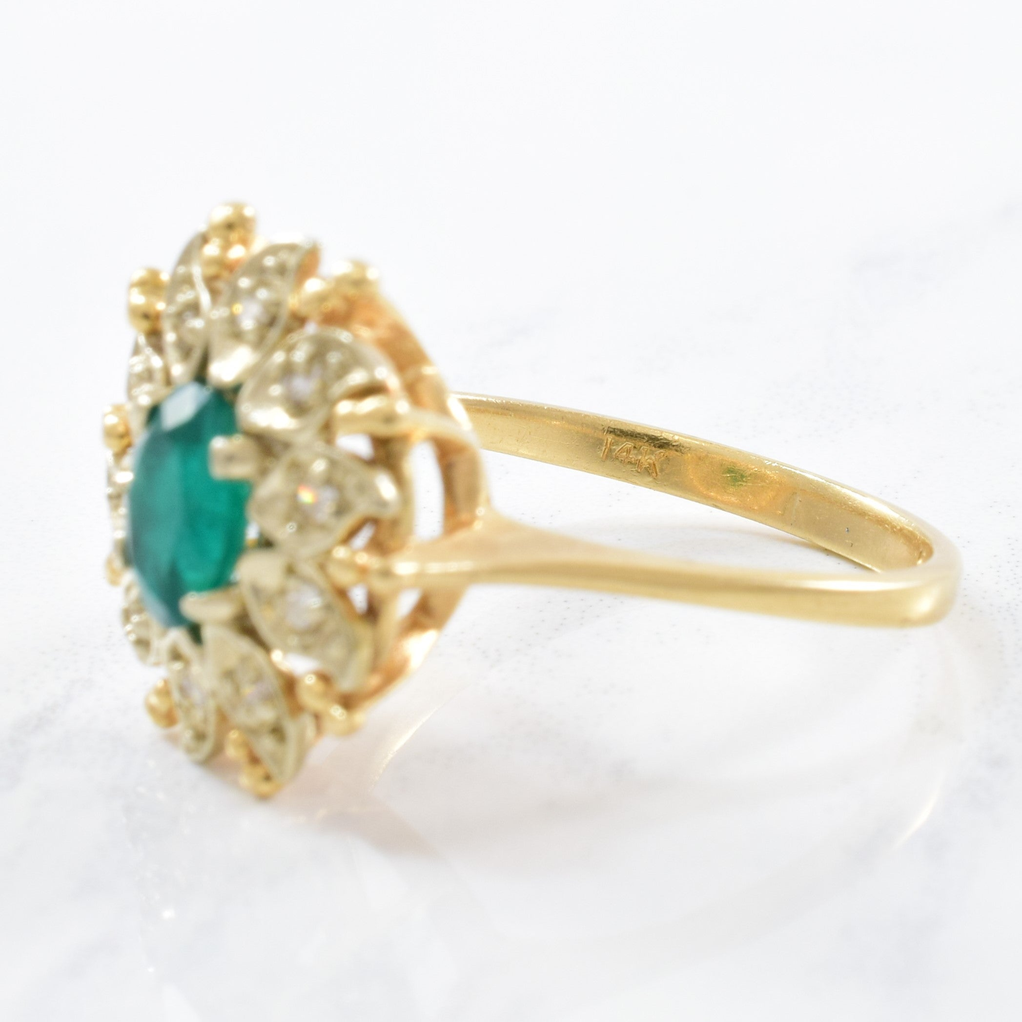 'Courtship' Floral Diamond Halo Emerald Ring Circa 1940s | 0.12ctw, 0.55ct | SZ 8 |