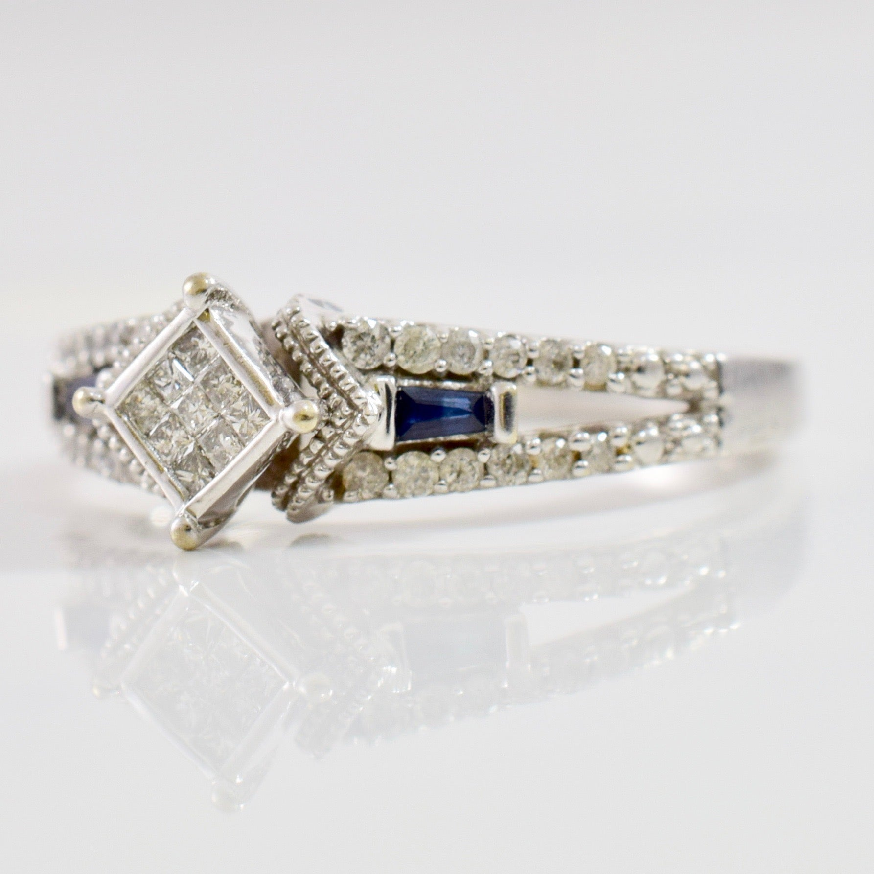 Diamond Cluster Ring with Tiny Sapphire Accents | 0.12 ctw SZ 6 |