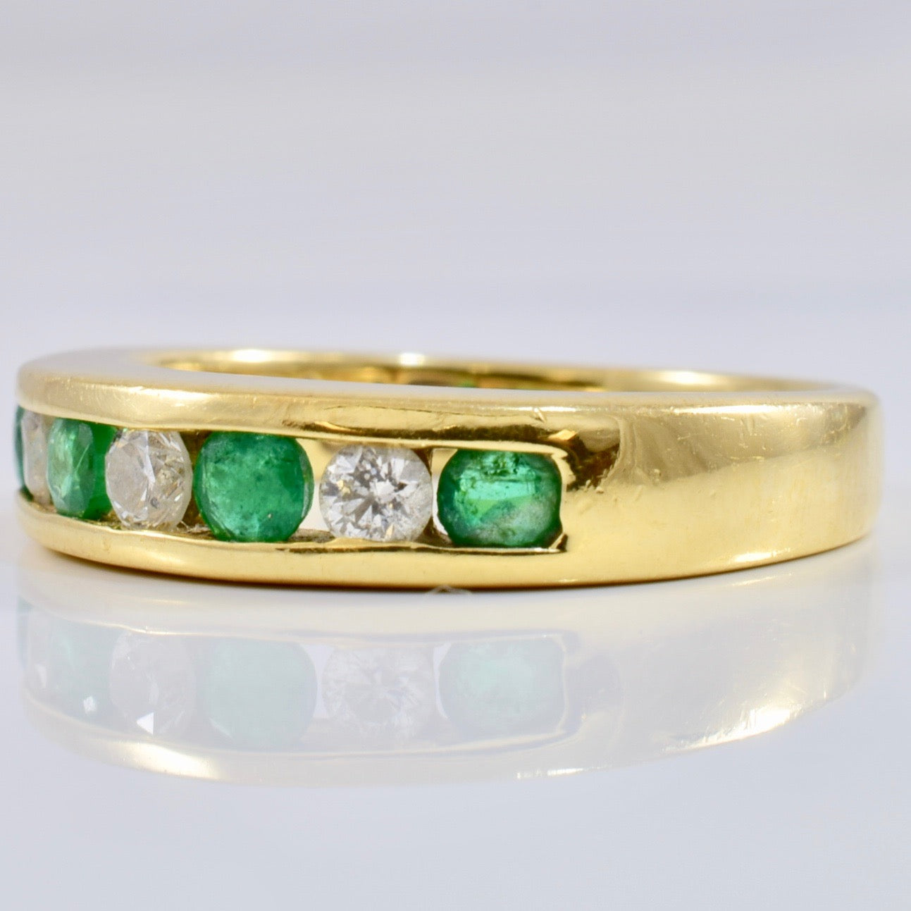 Channel Set Diamond and Emerald Ring | 0.18 ctw SZ 5.75 |