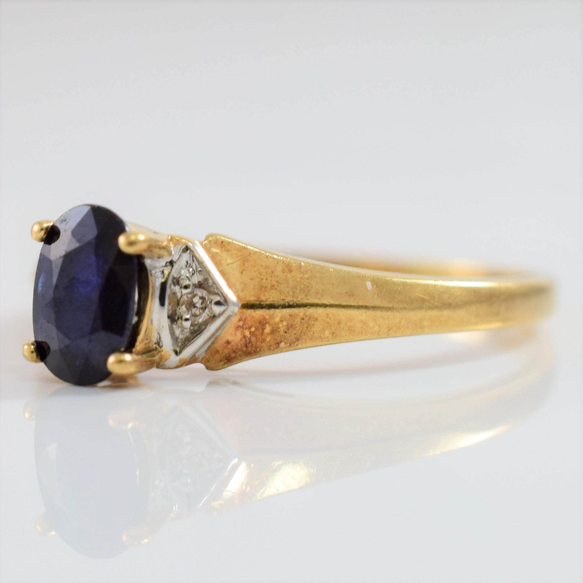 Sapphire and Diamond Accent Ring | 0.01 ctw SZ 7 |