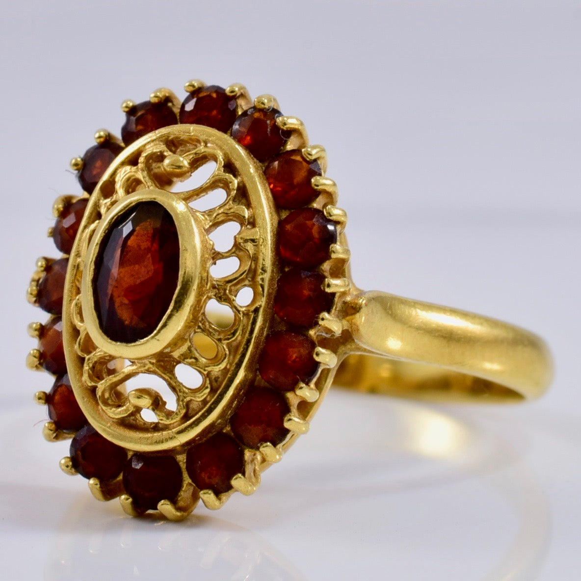 Intricate Gold and Garnet Ring | 0.75 ctw SZ 6.5 |