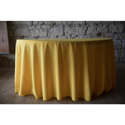 "120"" Round Yellow Gold Solid Polyester Tablecloth shown on 5 ft round table"