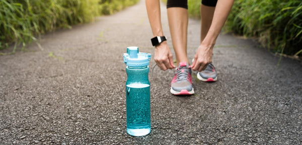 water bottle with runner behind