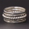 A set of 5 handmade sterling silver stacking rings by Rebecca Cordingley