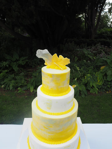 FOUR TIERED YELLOW AND GREY WATERCOLOUR BIRTHDAY CAKE