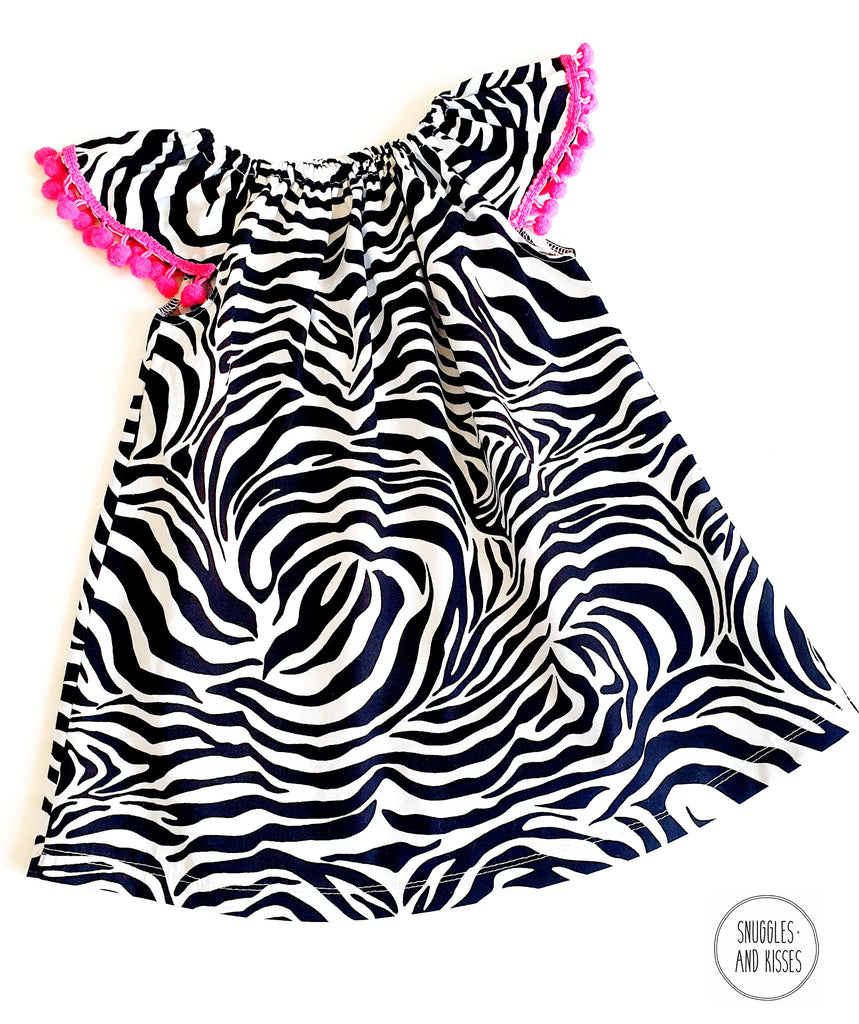Zebra Print Cotton Dress with Pom Poms - Snuggles and Kisses
