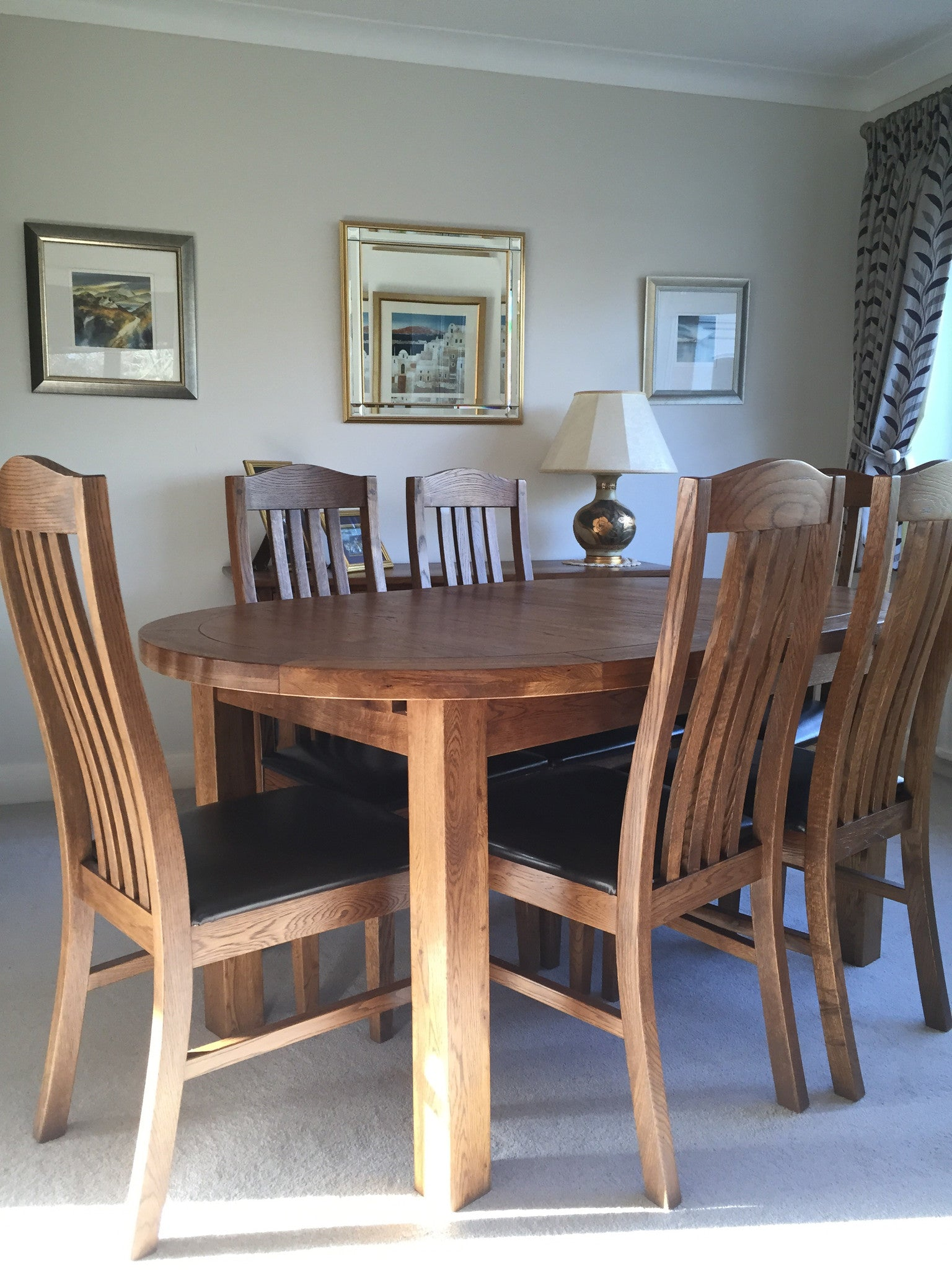 The Empire Oval Extending Dining Table