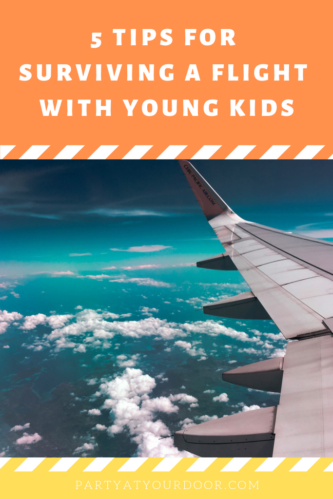 5 Tips For Surviving A Flight With Young Kids