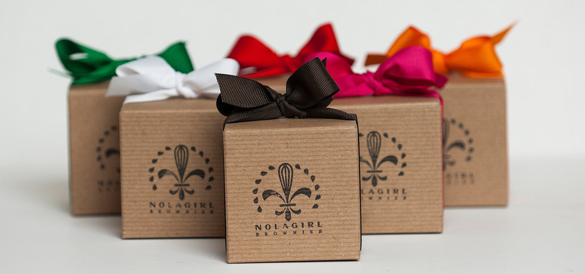 Beautiful kraft colored boxes of NOLA Girl Brownies with colored ribbons.