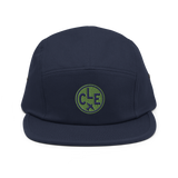RWY23 - CLE Cleveland Airport Code Camper Hat - City-Themed Merchandise - Roundel Design with Vintage Airplane - Image 1