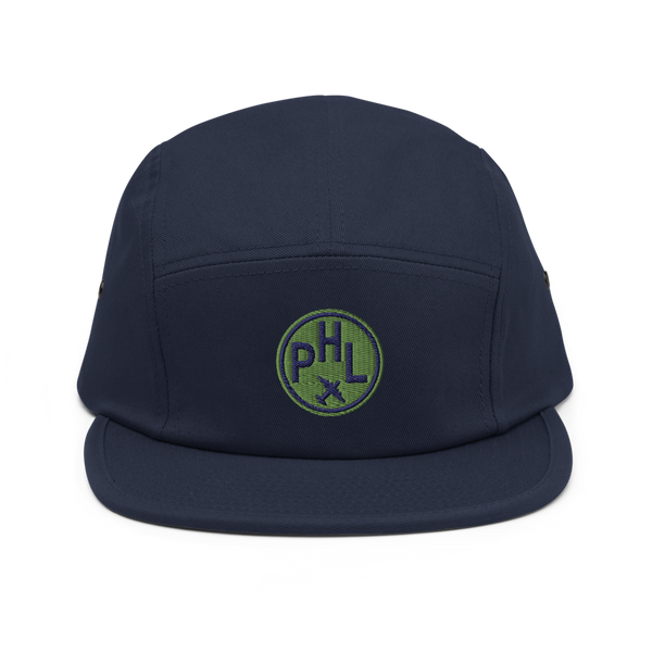 RWY23 - PHL Philadelphia Airport Code Camper Hat - City-Themed Merchandise - Roundel Design with Vintage Airplane - Image 1