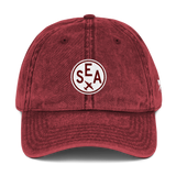 RWY23 - SEA Seattle Cotton Twill Cap - Airport Code and Vintage Roundel Design - Maroon - Front - Aviation Gift