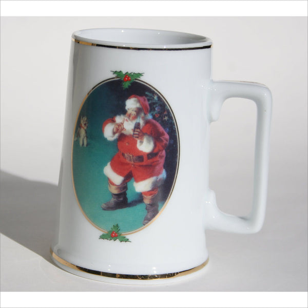 1961 Coca Cola Classic Santa Painting quieting a noisy schnauzer to avoid waking the family Gold Rimmed Christmas Mug