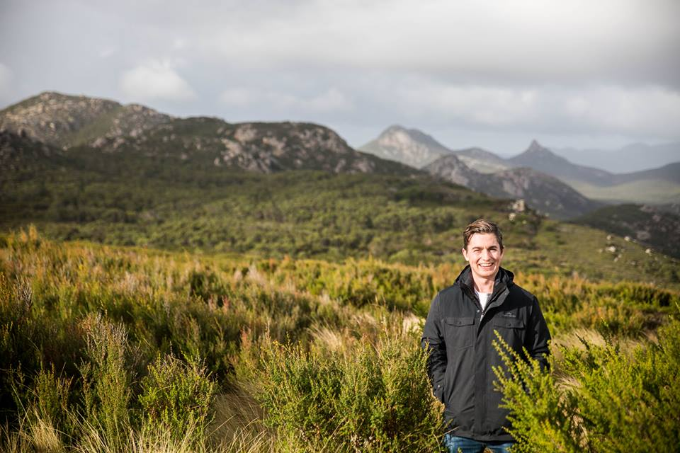 Zea Relief Managing Director, Hayden Brass, surrounded by Tasmanian Kunzea ambigua plants