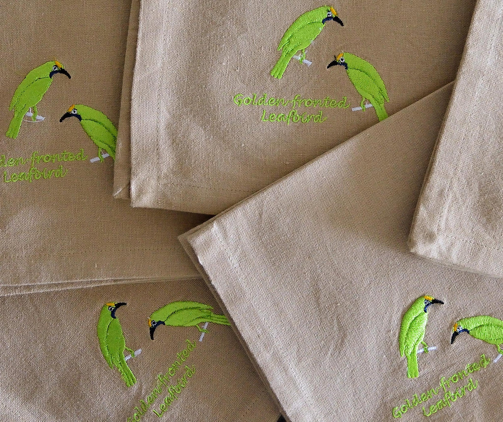 EMBROIDERED NAPKINS: GOLDEN FRONTED LEAFBIRD ON A BEIGE COLOURED NAPKIN