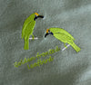 EMBROIDERED NAPKINS: GOLDEN FRONTED LEAFBIRD ON A SLATY OLIVE GREEN COLOURED NAPKIN