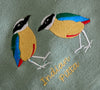 EMBROIDERED NAPKINS: INDIAN PITTA ON A SLATY OLIVE GREEN COLOURED NAPKIN