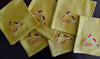 EMBROIDERED NAPKINS: FIRE TAILED SUNBIRD ON A MUSTARD YELLOW COLOURED NAPKIN