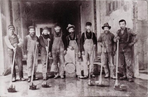 A historic photo of terrazzo grinders and finishers prior to the 1920s, courtesy Venice Art Terrazzo Company.