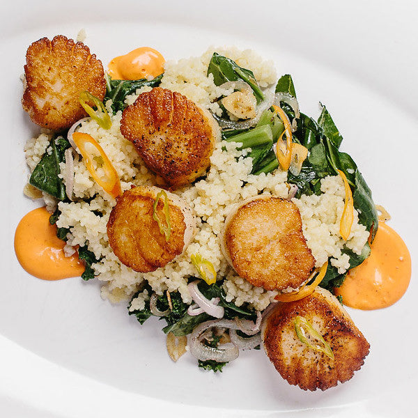 Seared Scallop over Wilted Greens & Couscous