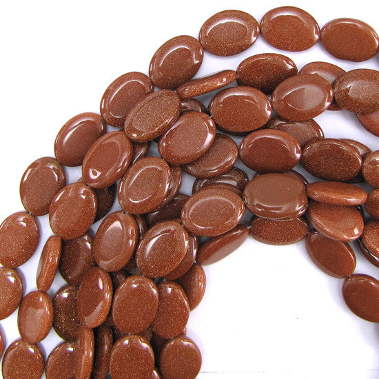 "18mm goldstone flat oval beads 16"" strand"