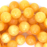14mm yellow jade round beads 15.5