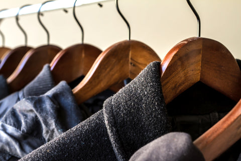 Winter clothes on wooden hangers