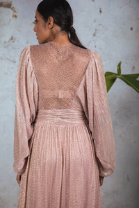 Rose gold platinoir full sleeve gown with balloon sleeves, embellished yoke and sheer embellished back.