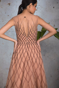 Nude sleeveless fully embellished criss cross net gown