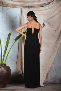 Black jersey draped gown with cut at waist and salli embellishment
